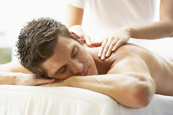 Young Man Enjoying Massage At Spa